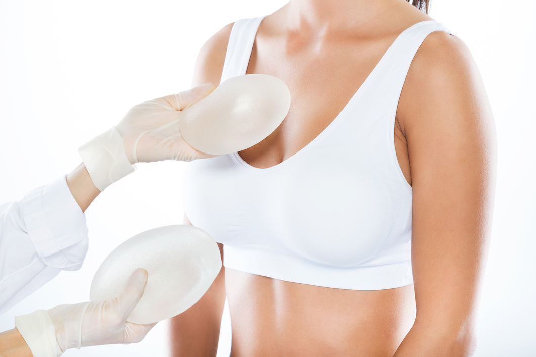 Doctor offering choice of breast implants