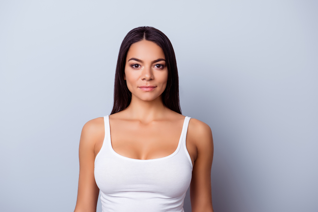 young lady wearing white vest