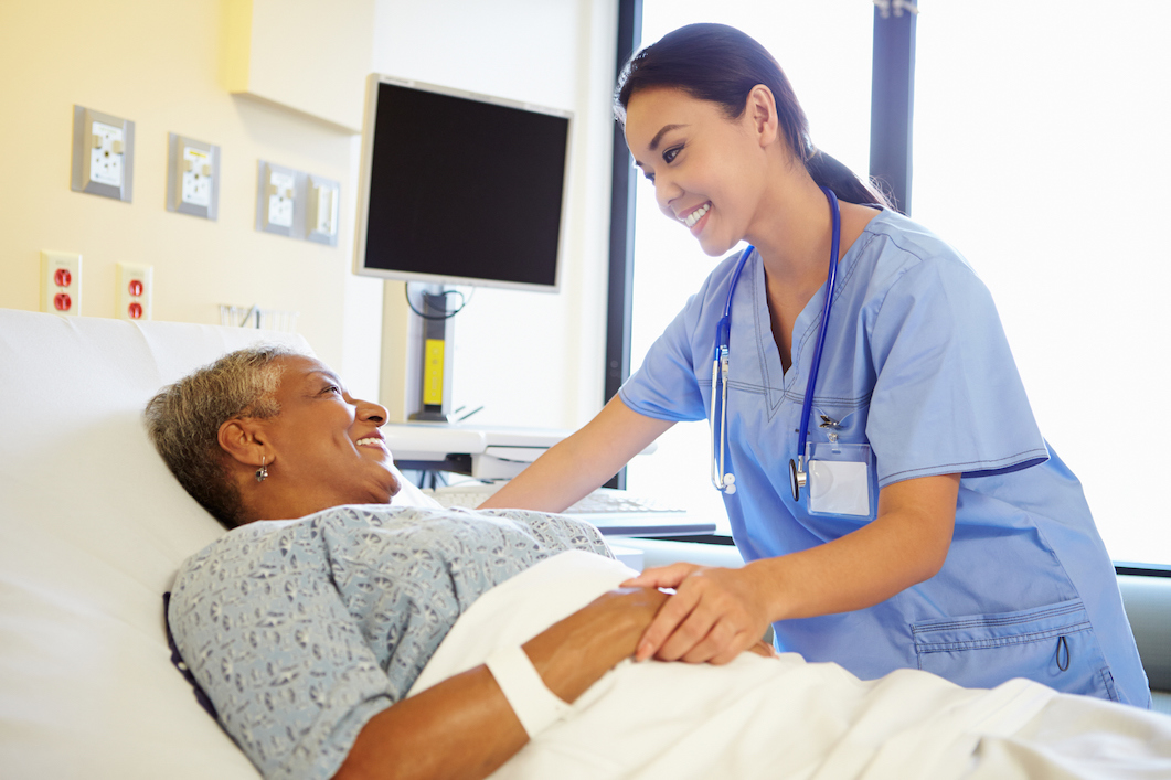 nurse caring for female patient after surgery